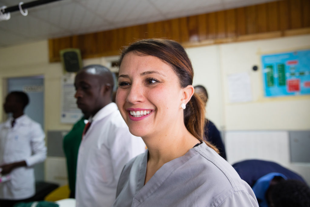 Medical staff stands and smiles