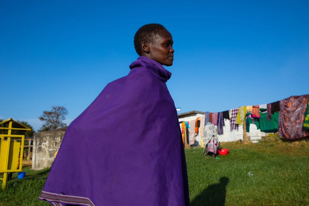 Woman wrapped in blanket stands