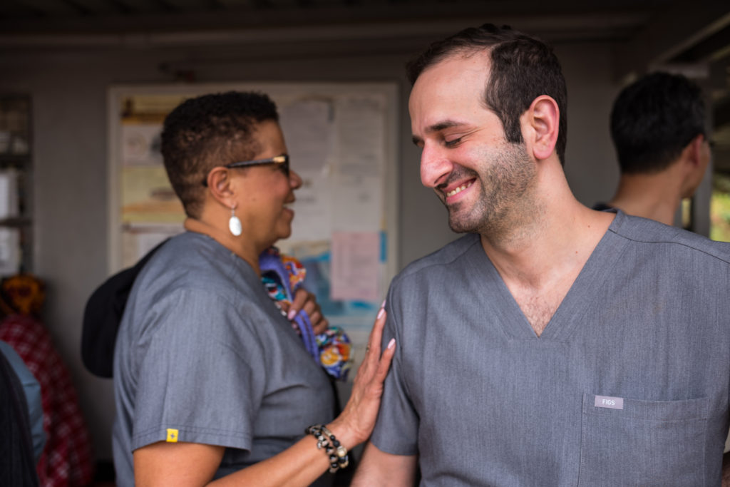 Medical staff talk and smile