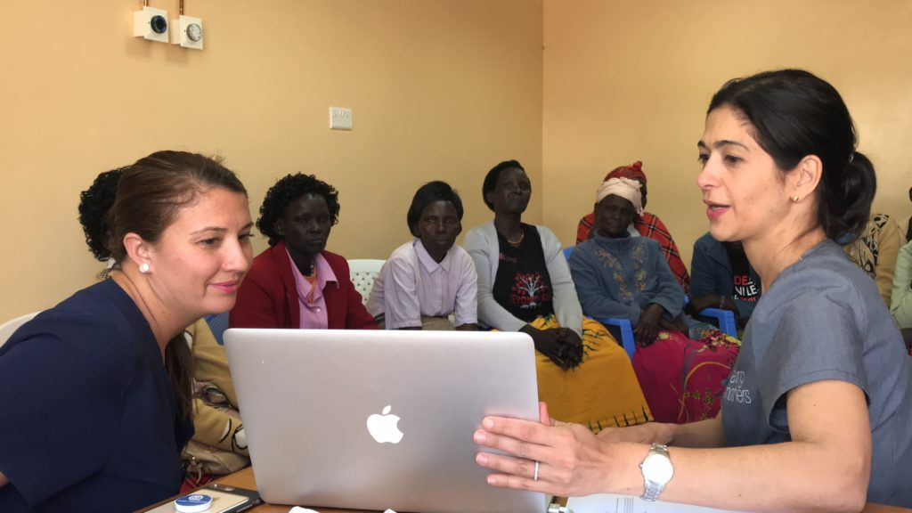 Woman shows presentation to a group